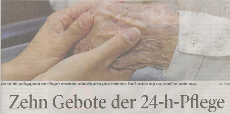 Beide Hände einer jüngeren Person halten die Hand einer älteren Person.